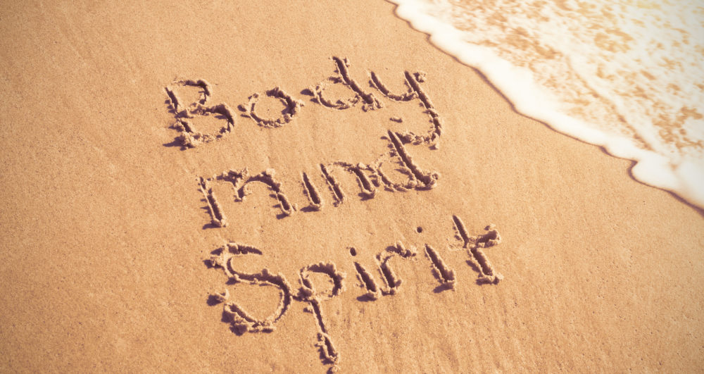 Body mind soul in zand